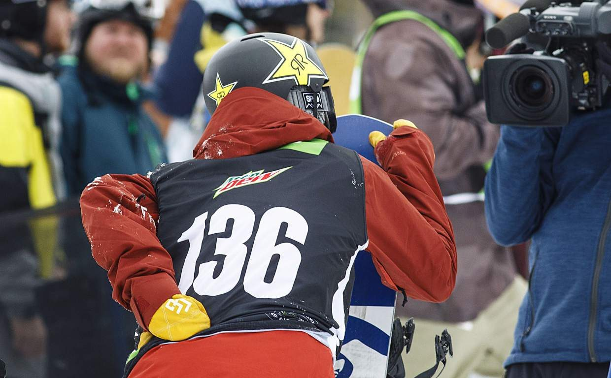 Chris Corning hangs his hand on the back following the last run in the slopestyle finals during the Dew Tour event Saturday, Dec. 16, at Breckenridge Ski Resort. Corning injured his back during the U.S. Grand Prix event at Copper Mountain last week.