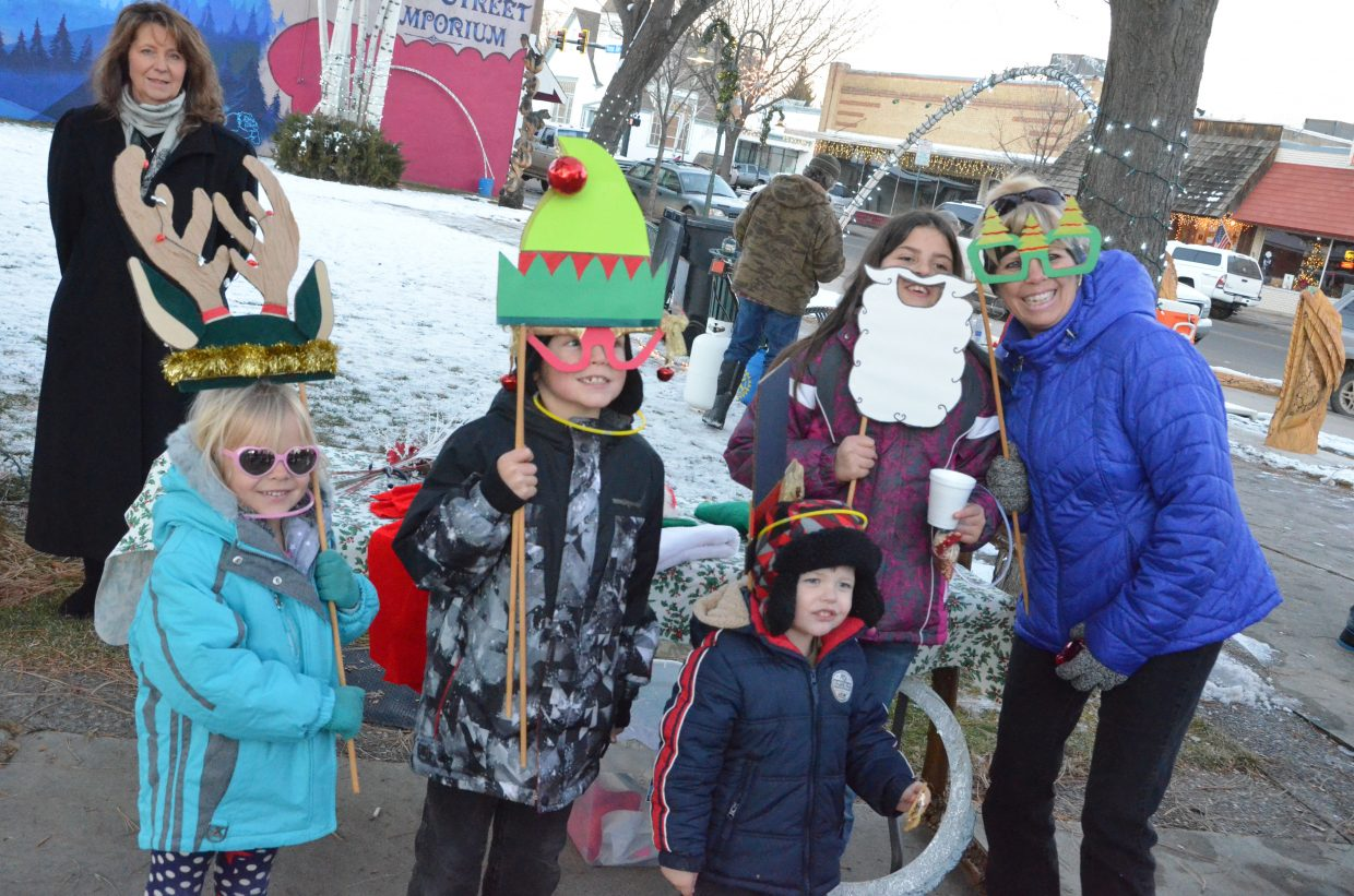From left, Keira Weston, Reece Weston, Anthony Rucker and Ayla Weston join their grandmother, Stephanie Harvey, pose with wacky holiday props with the elfie selfie station at Down Home Christmas Celebration in Alice Pleasant Park. The yearly downtown holiday gathering included many family activities.