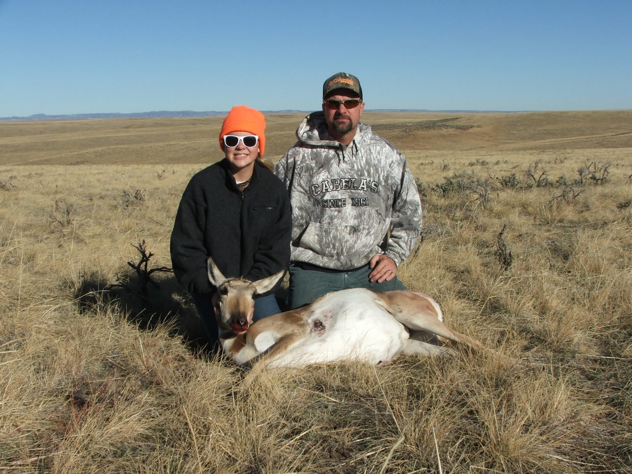 Emma Schlim wiht her first pronghorn, taken northwest of Craig