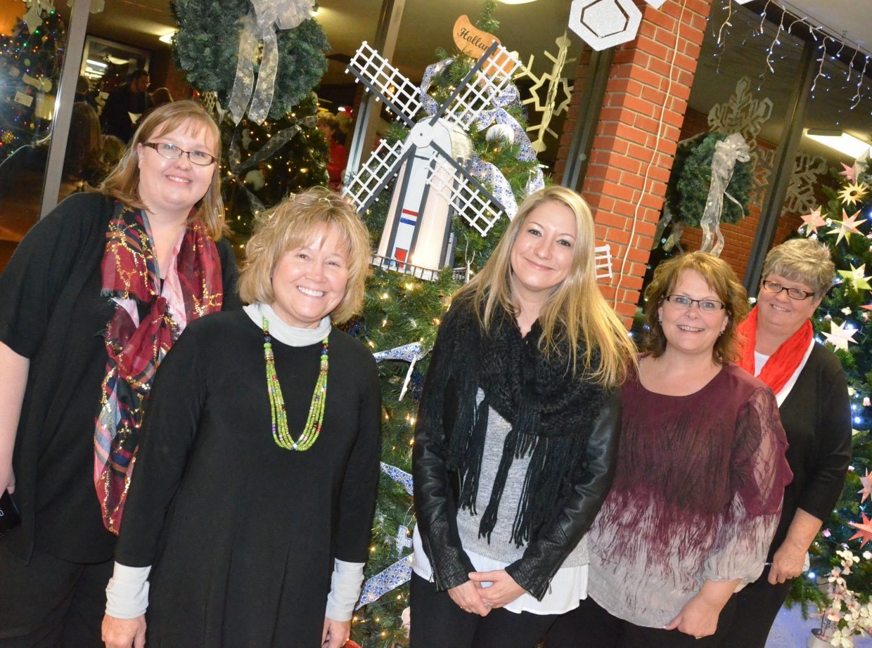 Moffat County seniors' Holland tree is displayed by the Festival of Trees committee at Moffat County Courthouse. From left, Amanda Arnold, Corrie Ponikvar, Shawnna Muhme, Lila Herod and Betsy Overton.