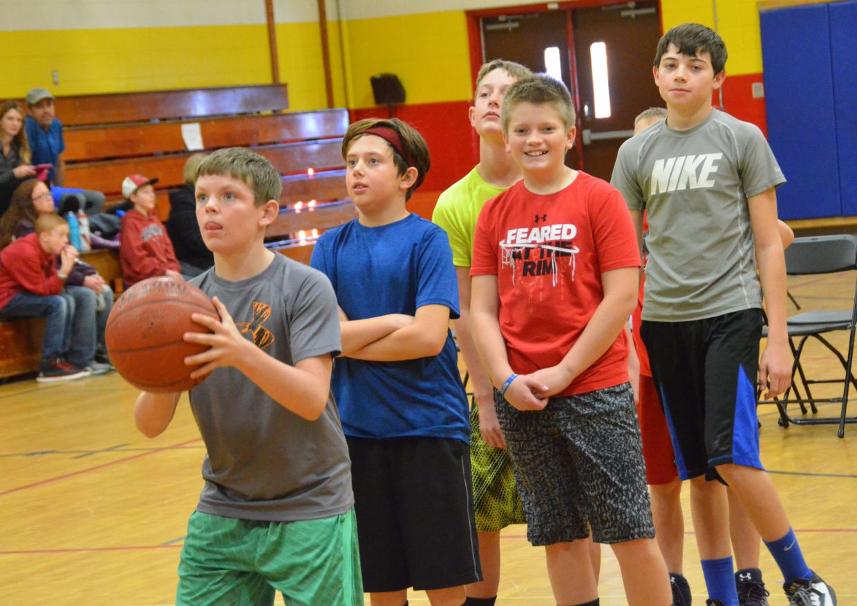 Craig boys line up for practice throws during Saturday's Elks National Hoop Shoot Free Throw Contest.