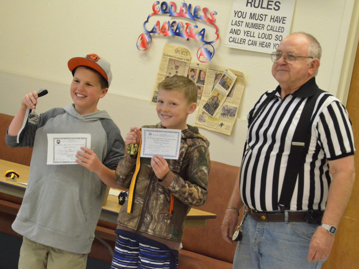 From left, Andrew Poole and Jayden Evenson display second- and first-place medals provided by Frank Sadvar as the local winners among 10- and 11-year-old boys of the Elks National Hoop Shoot Free Throw Contest.