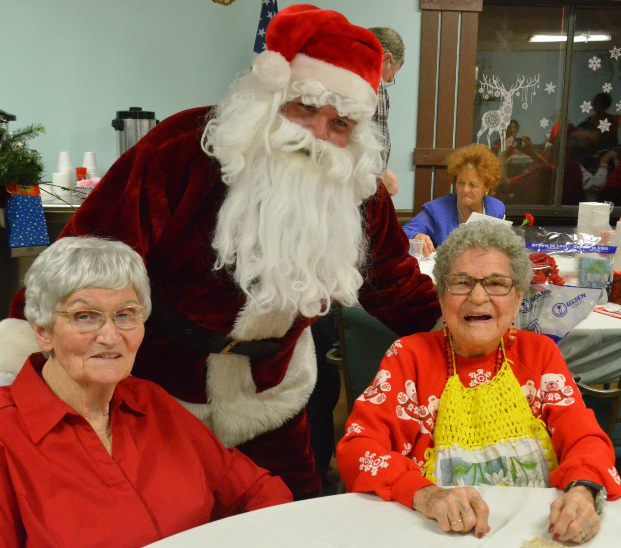 Santa Claus, on behalf of Craig Kiwanis Club, visits with Sunset Meadows residents during a Wednesday Christmas party. Santa joined Kiwanis members as they dropped by Sunset Meadows and Sandrock Ridge.