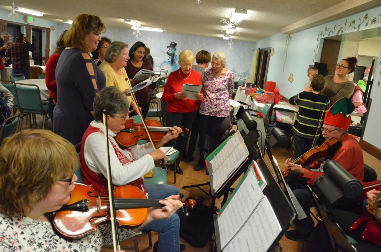 Cedar Mountain Strings provides musical accompaniment as a rendition of