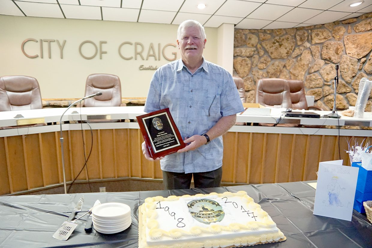 Chief of Police Walt Vanatta is celebrated by residents during a retirement party at the City of Craig.