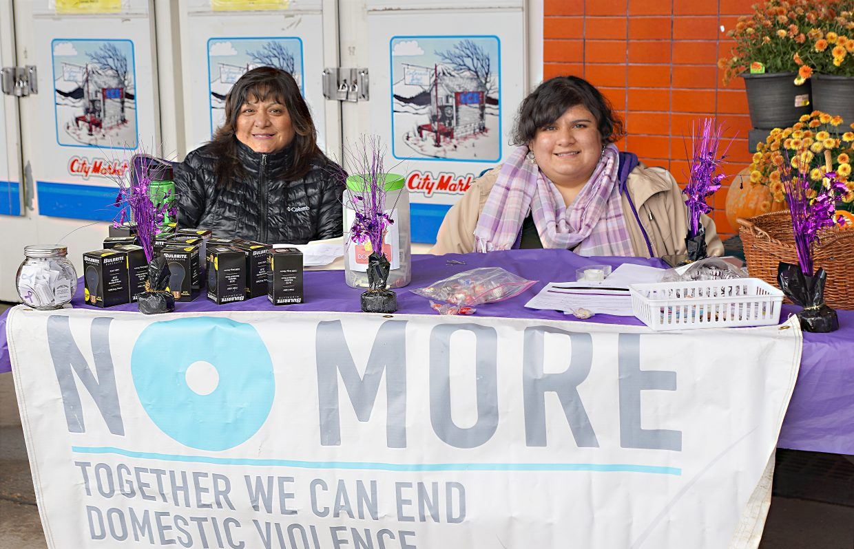 Advocates Latina Outreach Coordinator Patricia Maradiegue, left, and her daughter Alejandra Ledesma work to support people in crisis and during October urged citizens to take a stand against Domestic Violence.