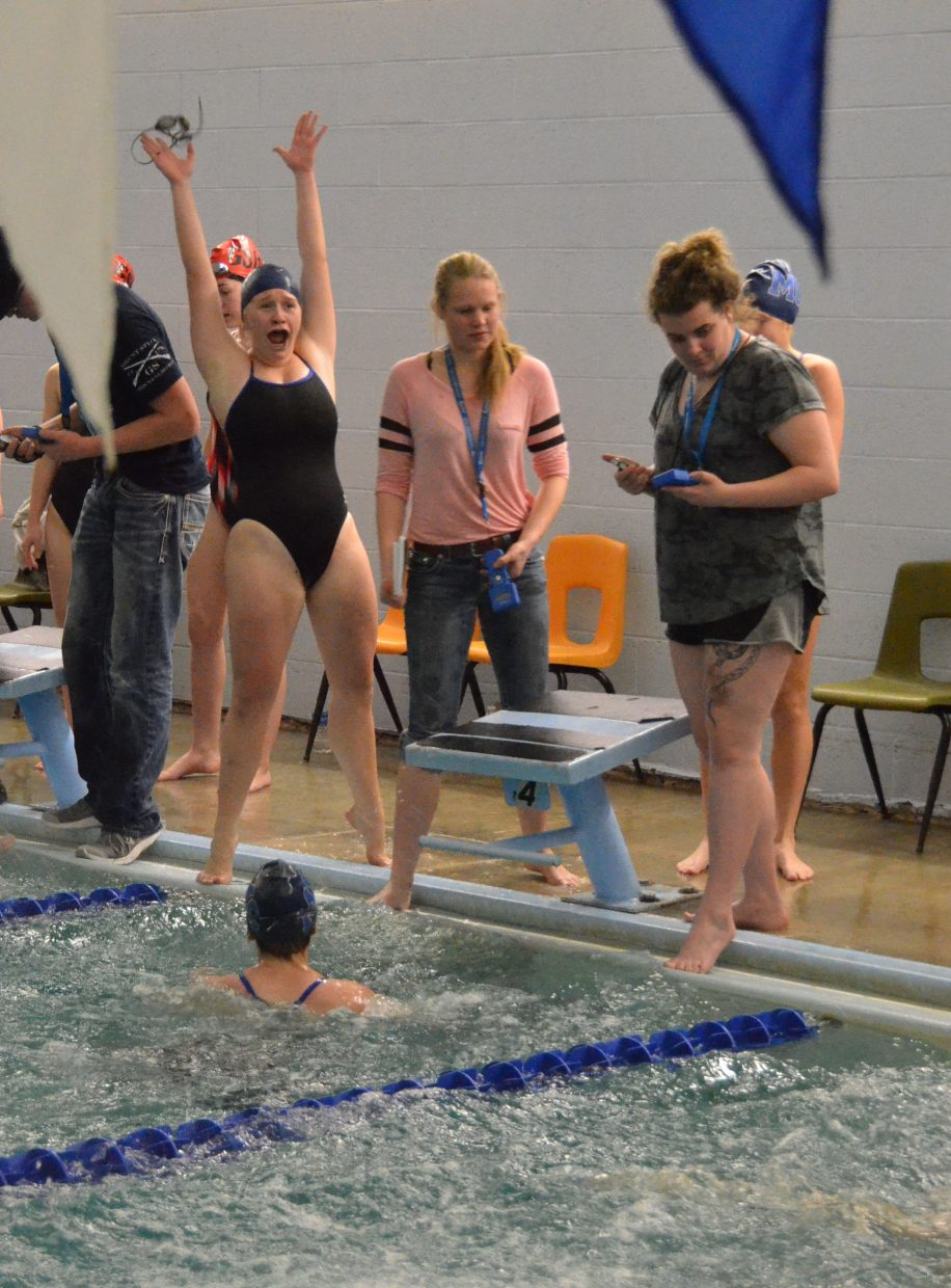 Moffat County High School's Molly Neton cheers as teammate Jeni Kincher finishes the 200-meter freestyle relay to give the Bulldogs a win during the Moffat County Meet.