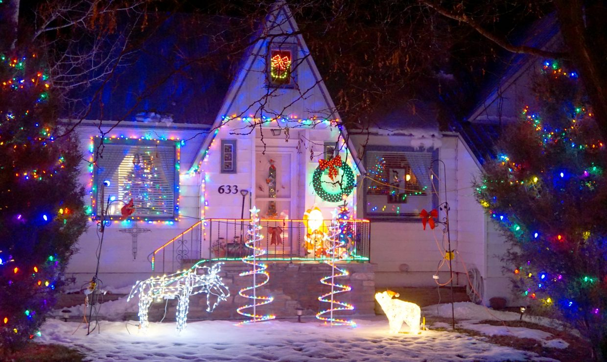 A moose and polar bear square off on the lawn of 633 Taylor St., one of the homes on the 2017 Holiday Tour or Lights.