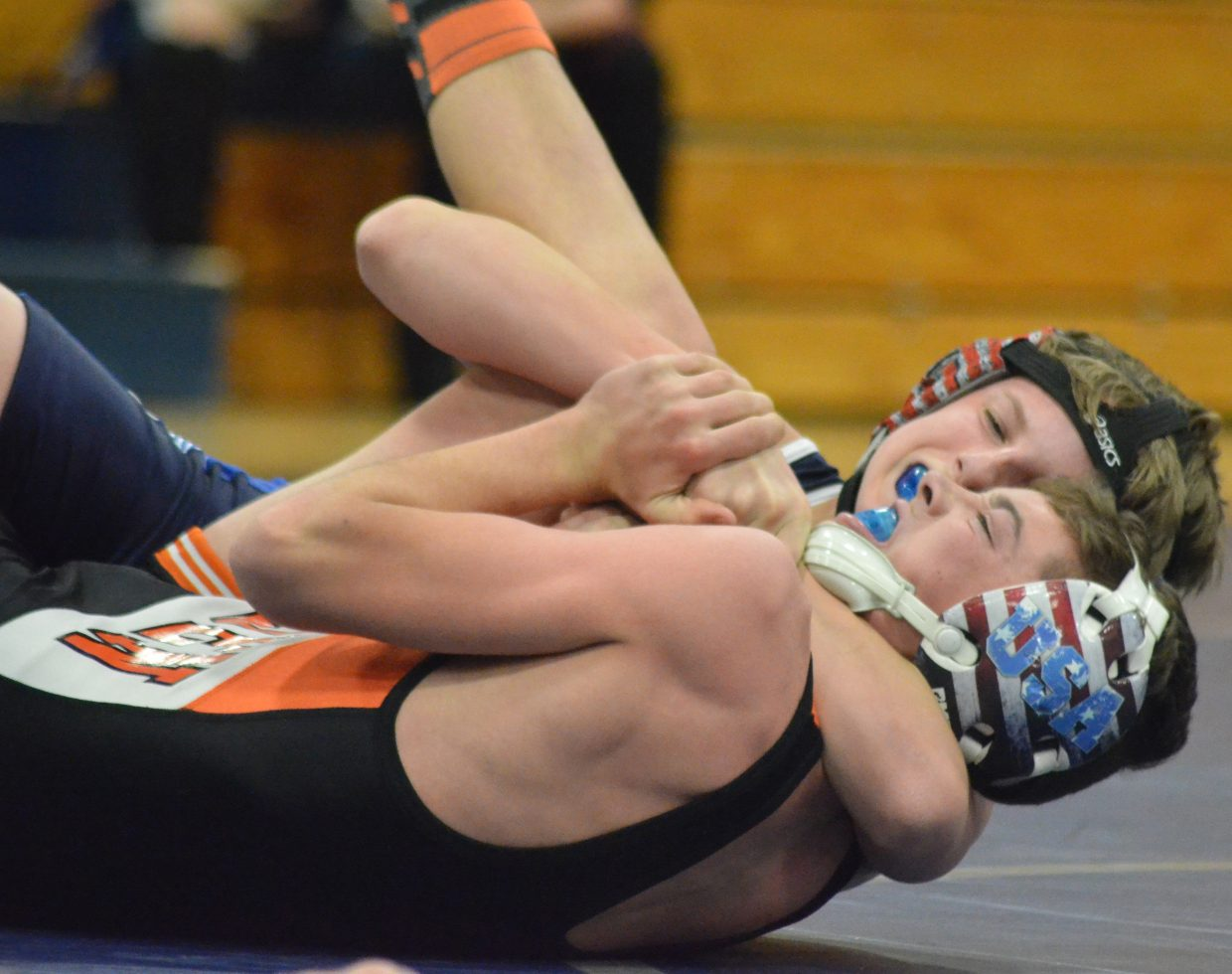 Moffat County High School's Slater Durbin and Hayden's Payton Planansky fight for dominance during a Thursday dual in Craig.