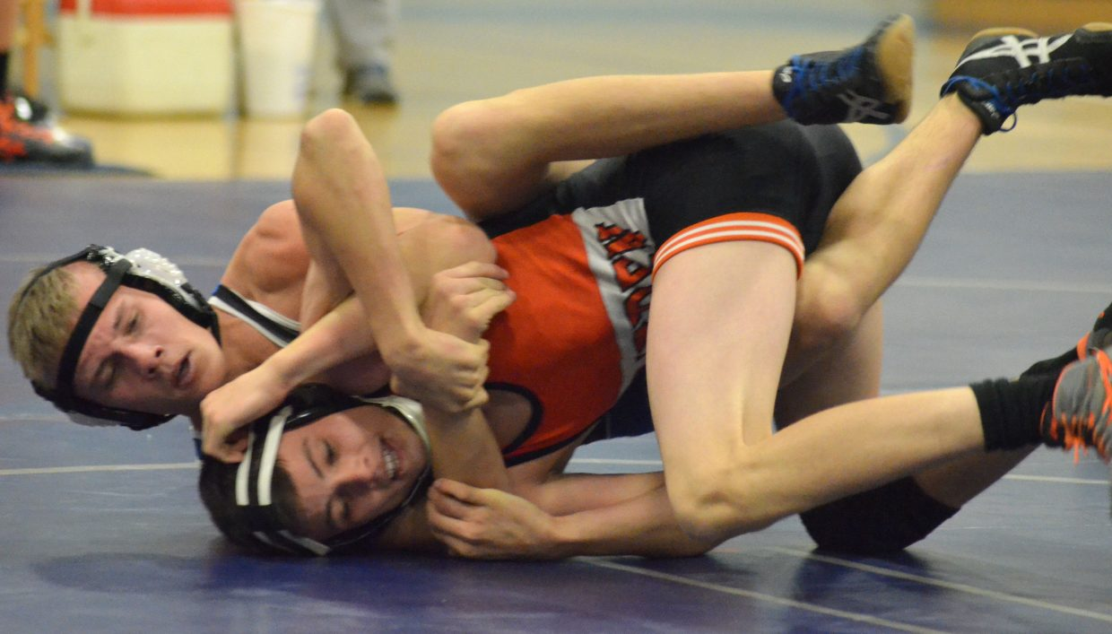 Moffat County High School's Coltyn Terry has Hayden's Wyatt Murphy locked up during a Thursday dual in Craig.