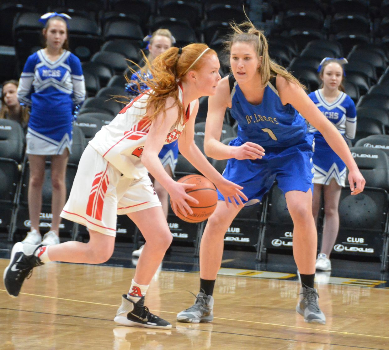 Moffat County High School's Brooke Gumber stays on her guard against Aspen.