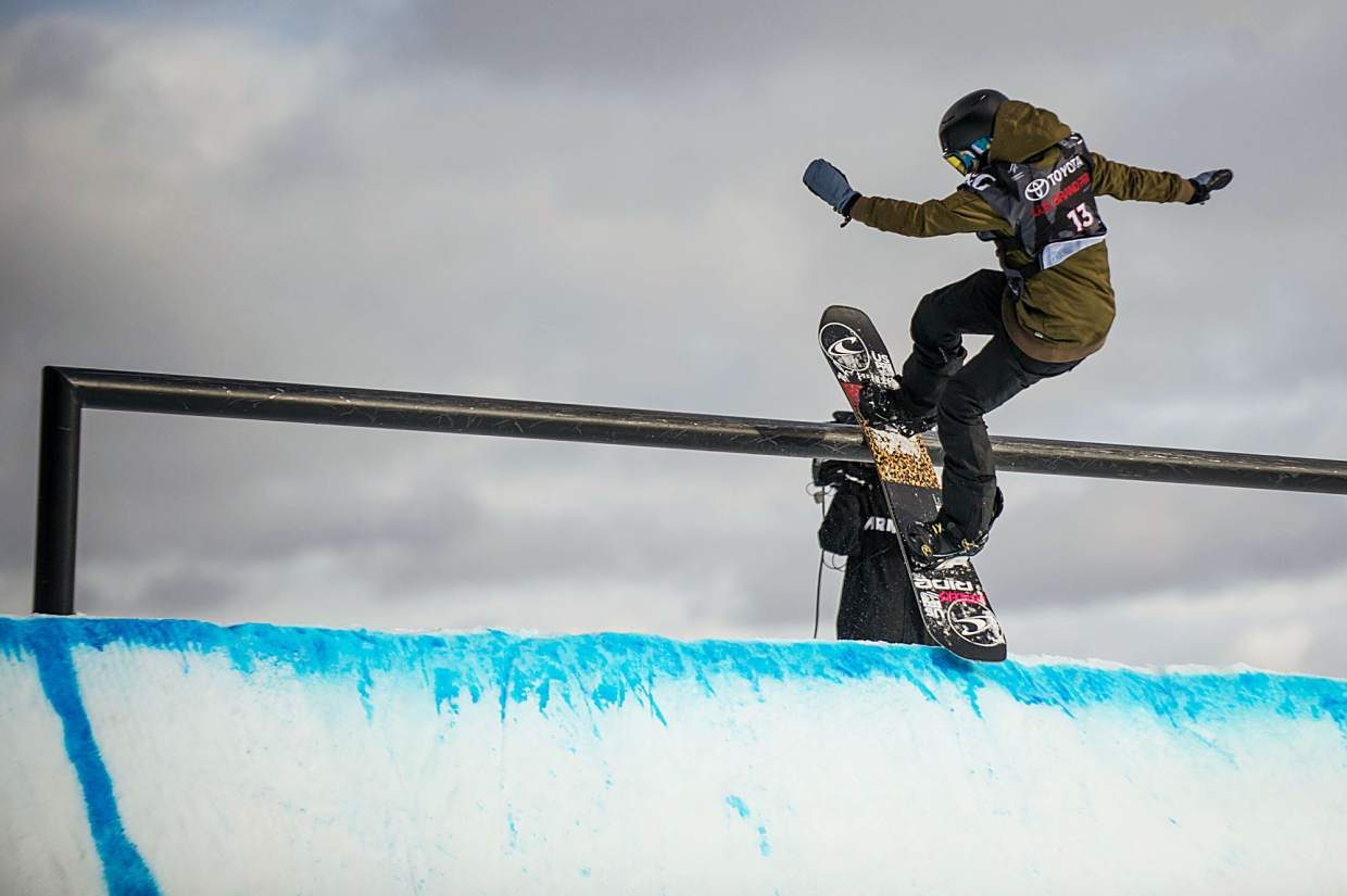 Jessika Jenson of the United States hits the rail on the quarter pipe during her first run in the women's snowboard slopestyle qualifiers at Snowmass for the U.S. Grand Prix on Wednesday. Jenson ranked first in the qualifiers.