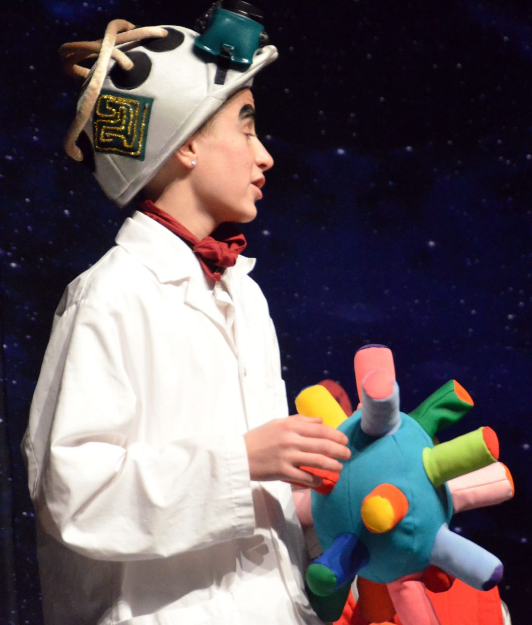 The maniacal scientist of Lapunta (Kasen Tansey) explains his plans in Missoula Children's Theatre's