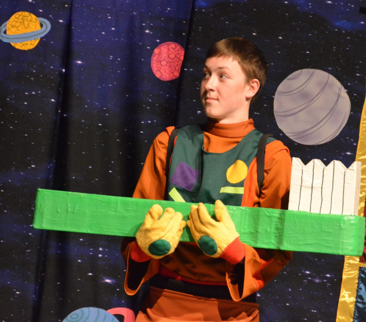 Gulliver (Alexander Nichols) is unsure what to make of an oversized toothbrush in Missoula Children's Theatre's