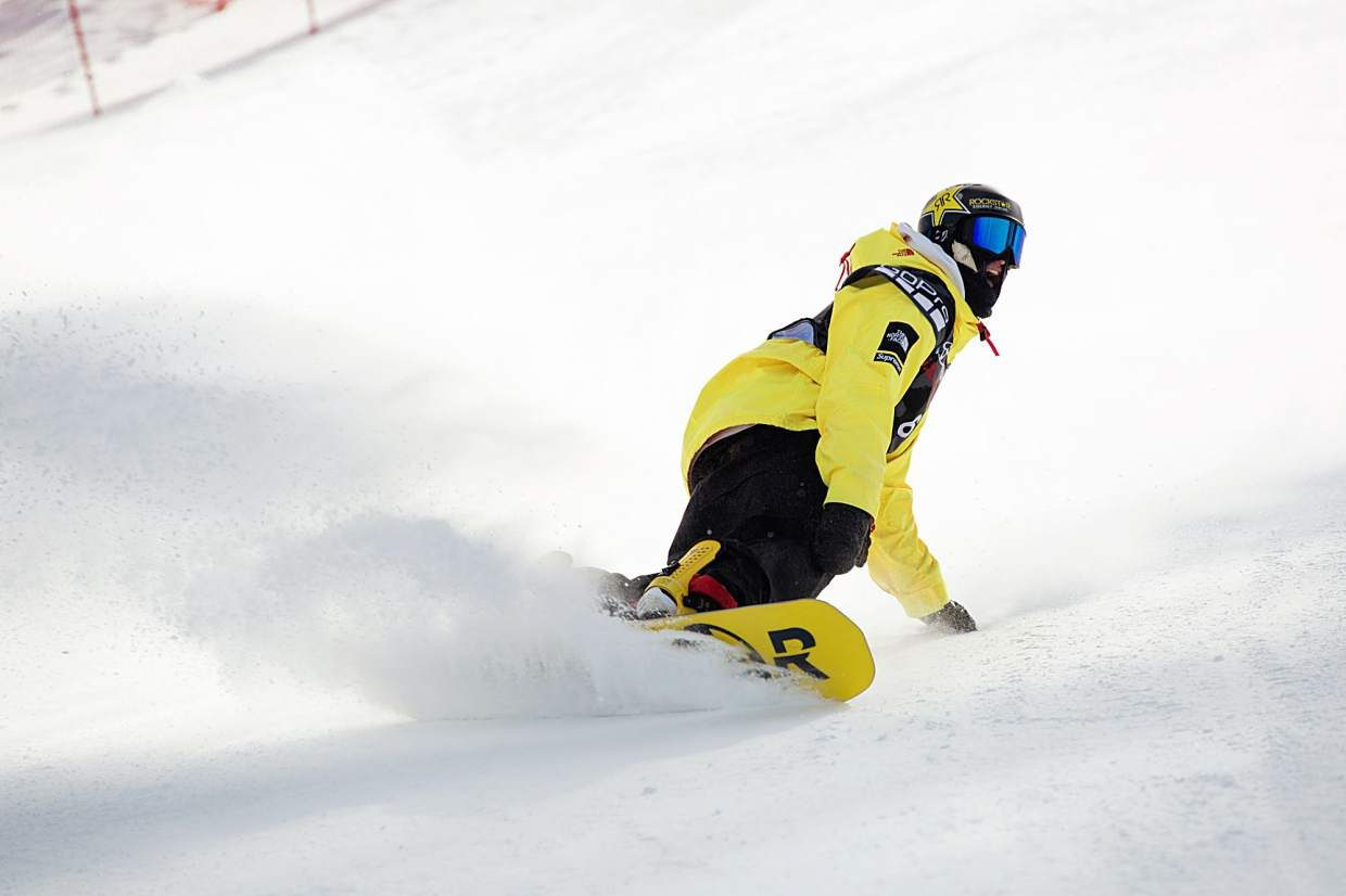 Kyle Mack excitedly carves a turn in fresh snow after landing his Toyota U.S. Grand Prix winning run at Mammoth Mountain in California on Saturday. The victory was enough to earn Mack a spot on the U.S. snowboard slopestyle and big air team at next month's Winter Olympics in Pyeongchang, South Korea.
