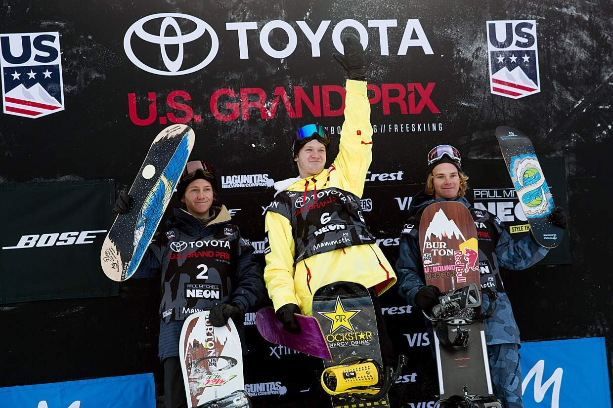 2018 Mammoth Mountain U.S. Grand Prix champion Kyle Mack (center) his fellow Silverthorne snowboarder and second place finisher Red Gerard (left) and third place finisher Brock Crouch of Mammoth Mountain, California are awarded at the podium at at Saturday's Toyota U.S. Grand Prix at Mammoth Mountain.
