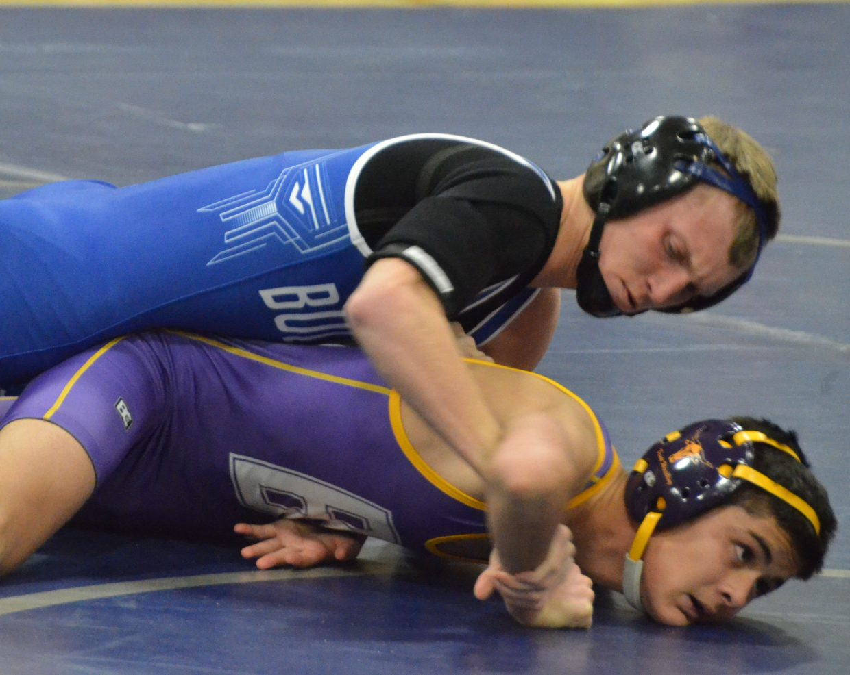 Moffat County High School's Karson Cox wastes no time in taking down Basalt's Axel Requeno during a Tuesday dual in Craig.