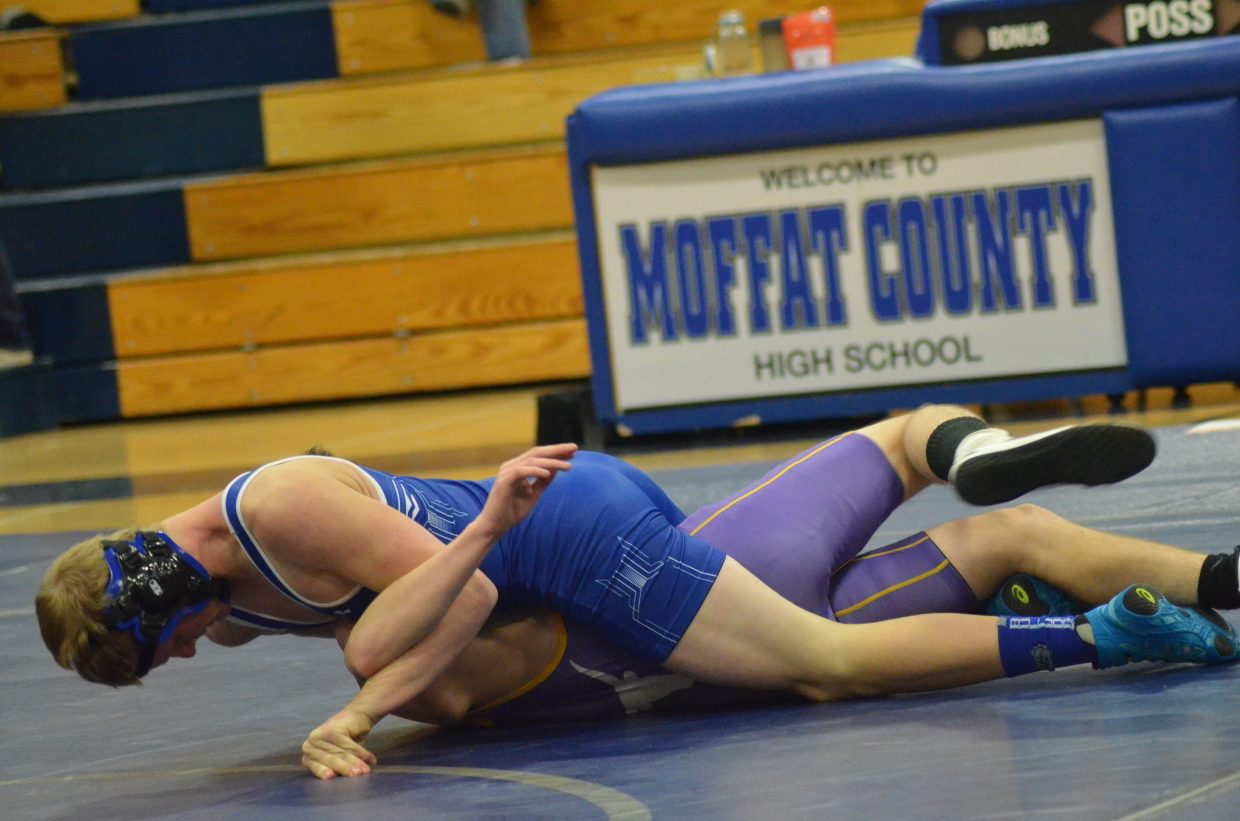Moffat County High School's Isiaih Herod works to get Basalt's Zach Pagan on his back during a Tuesday dual in Craig.