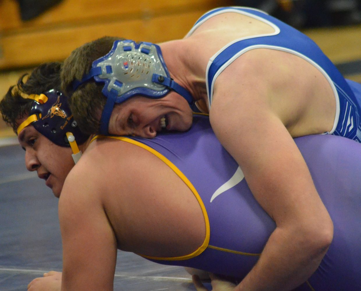 Moffat County High School's Toryn Hume won't let Basalt's Ernie Lopez escape during a Tuesday dual in Craig.