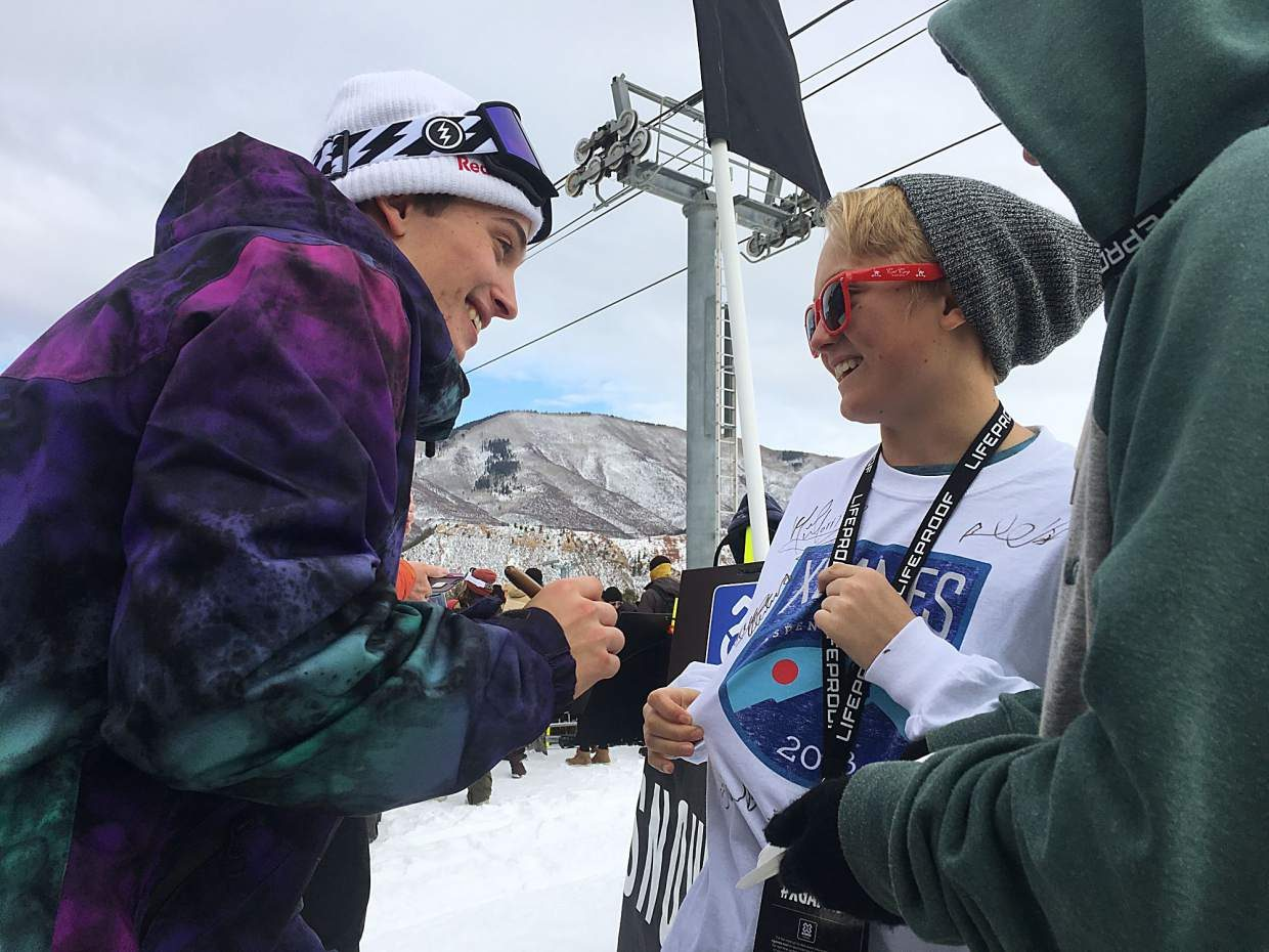 Snowboard slopestyle champion Marcus Kleveland of Norway stops to sign a shirt for an X Games fan Saurday at Buttermilk Mountain. Kleveland won his second consecutive gold in Aspen.