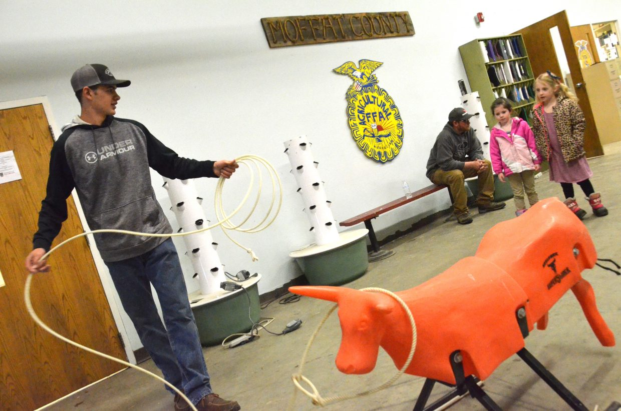 Carlin King demonstrates the art of the lasso during Barnyard Day hosted by Moffat County High School Future Farmers of America.