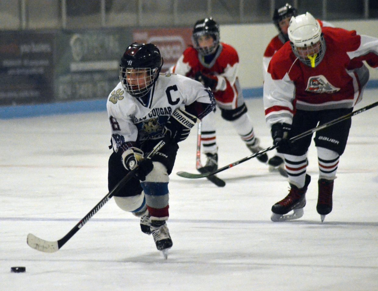 Craig Cougars' Grant Sis gets on a breakaway during a game against Rock Springs, Wyoming. The 10U Squirts took a tie and a win against the Miners in non-league games.