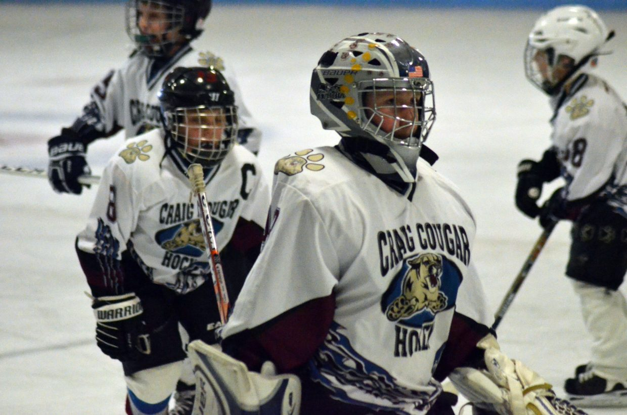 Craig Cougars goalie Quinn Allen leads his team off the ice following a game against Rock Springs, Wyoming.