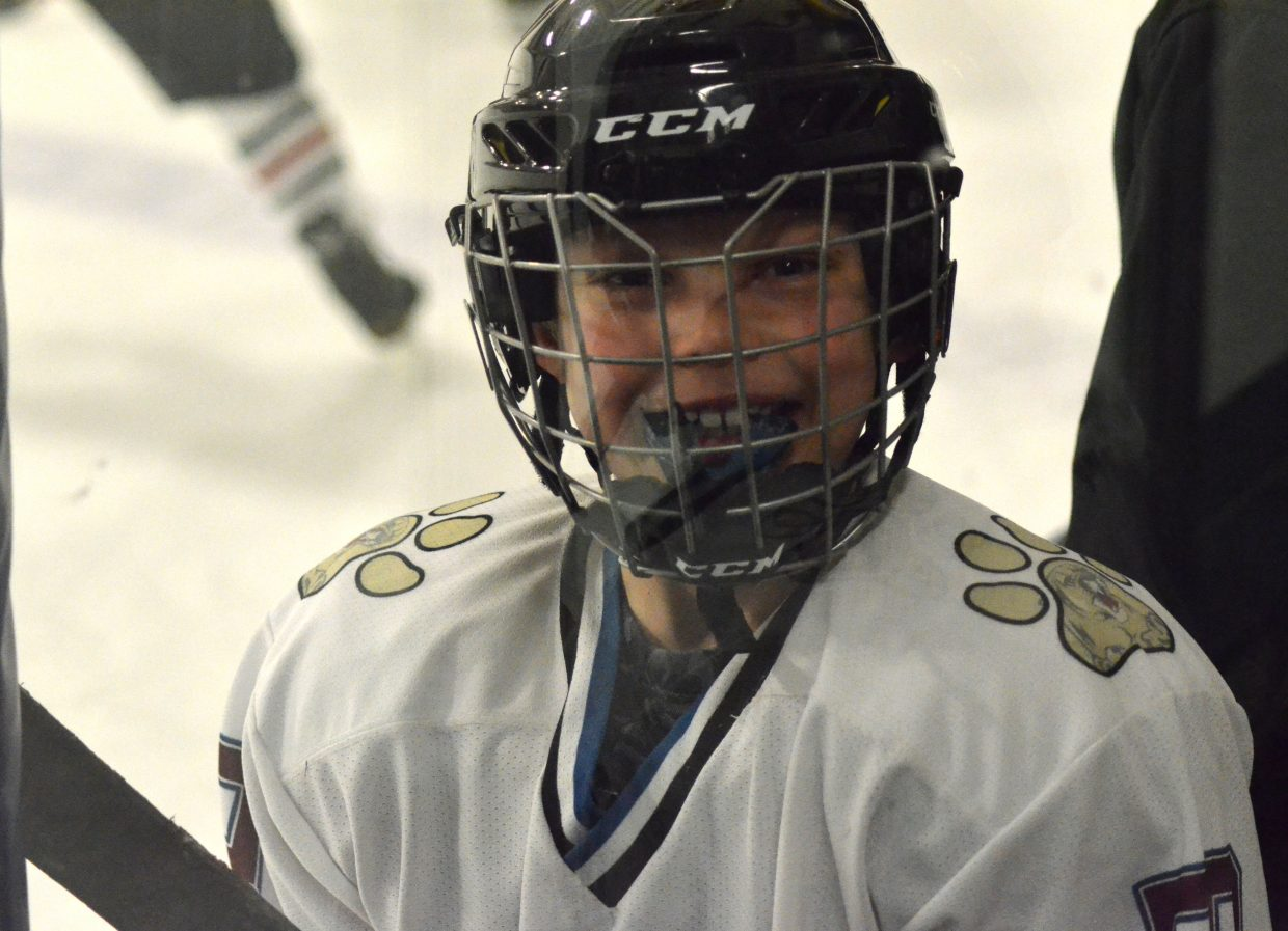 Craig Cougars' Eli Francone grins from the team bench during a game against Rock Springs, Wyoming.