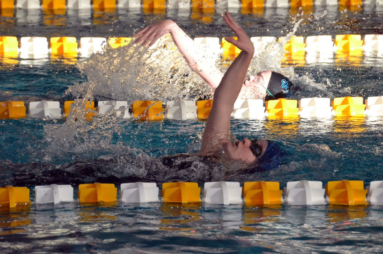 Moffat County High School's Molly Neton speeds along in the 100-yard backstroke Saturday at the Southwestern Conference League Championships.