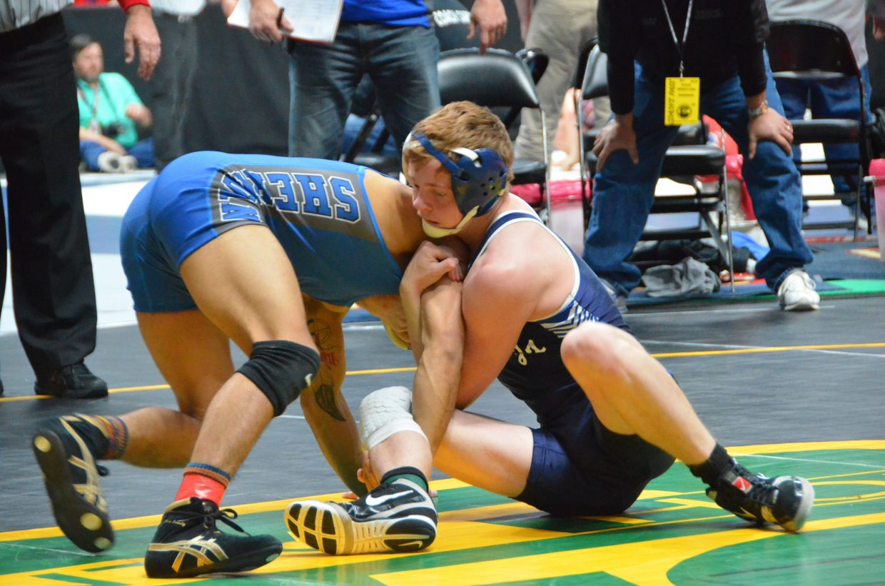 Moffat County High School wrestler Chris Moschetti stays competitive with Sheridan's Homero Navarro during CHSAA State Championships.