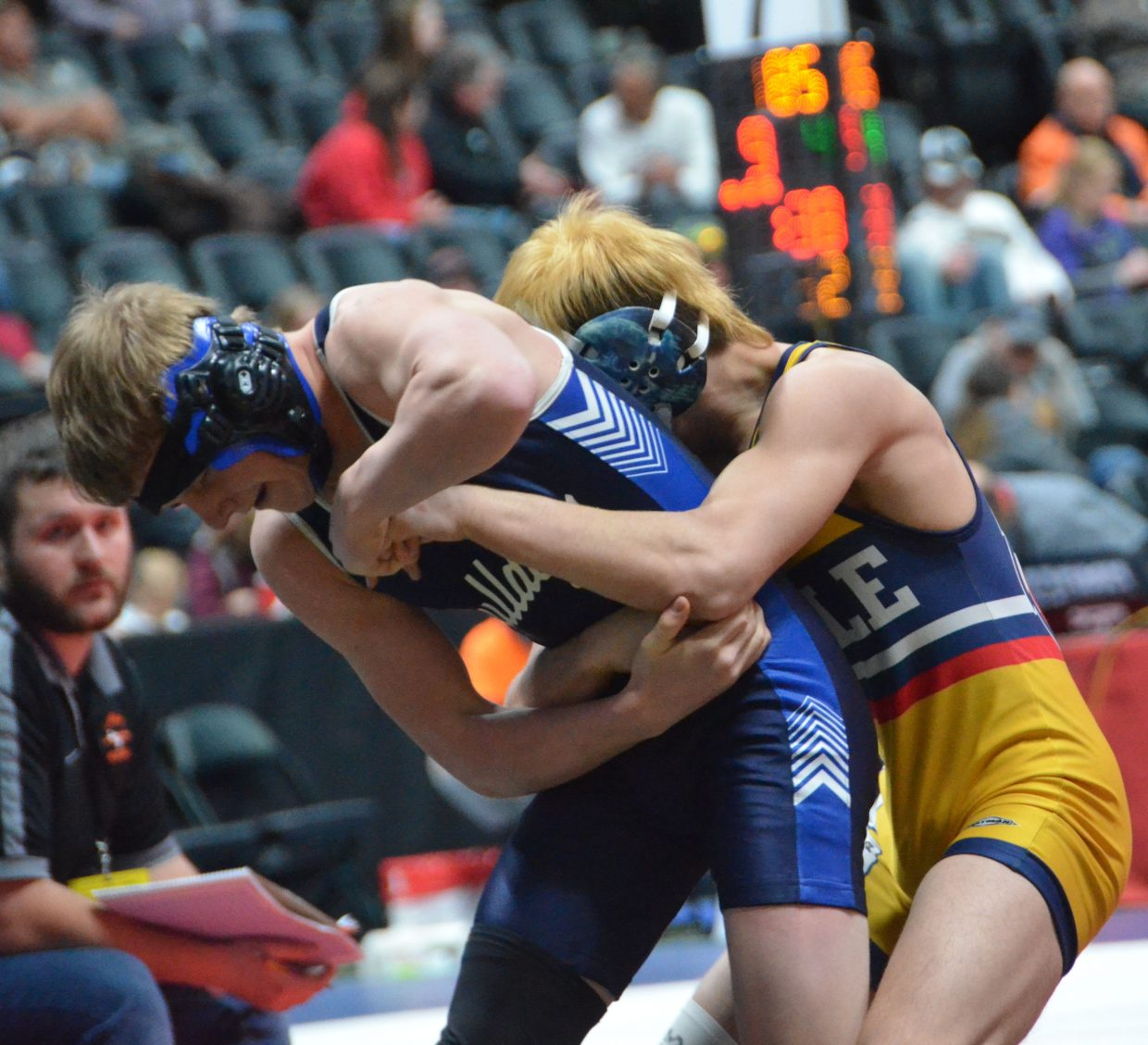 Moffat County High School wrestler Isiaih Herod works to break the grip of Rifle's Cauy Smith during CHSAA State Championships.