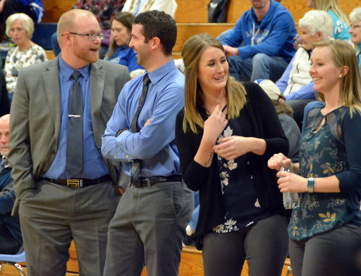 From left, Moffat County High School basketball coaches Kenley Nebeker, Joe Padon, Tanya Twitchell and Shalyn Steffan stay light-hearted as players warm up before Friday's game with Bishop Machebeuf.