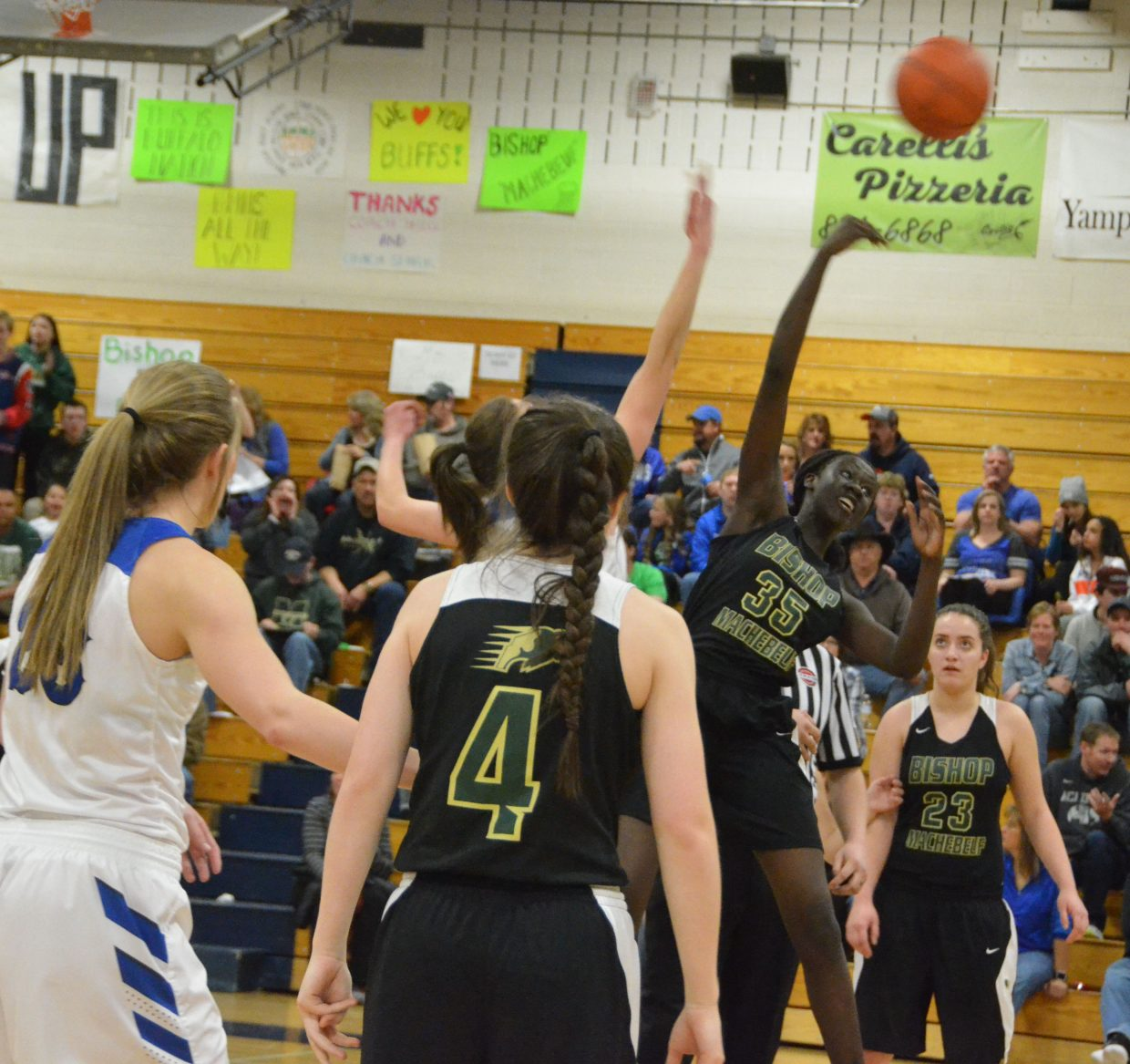 Bishop Machebeuf's Adet Mebany wins the opening tipoff in the Round of 32 at Moffat County High School.