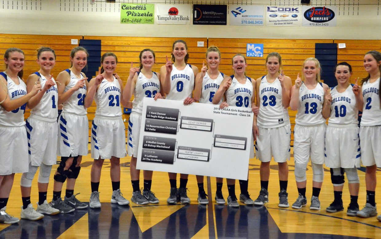 Moffat County High School varsity players proudly display the regional brackets of the 3A CHSAA State Championships. Eighth-seeded MCHS will face No. 1 Kent Denver in the Great 8.