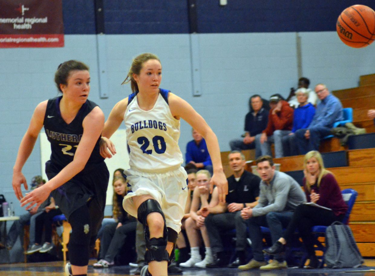 Moffat County High School's Madie Weber and Lutheran's Lexi Wilmoth pursue a loose ball.