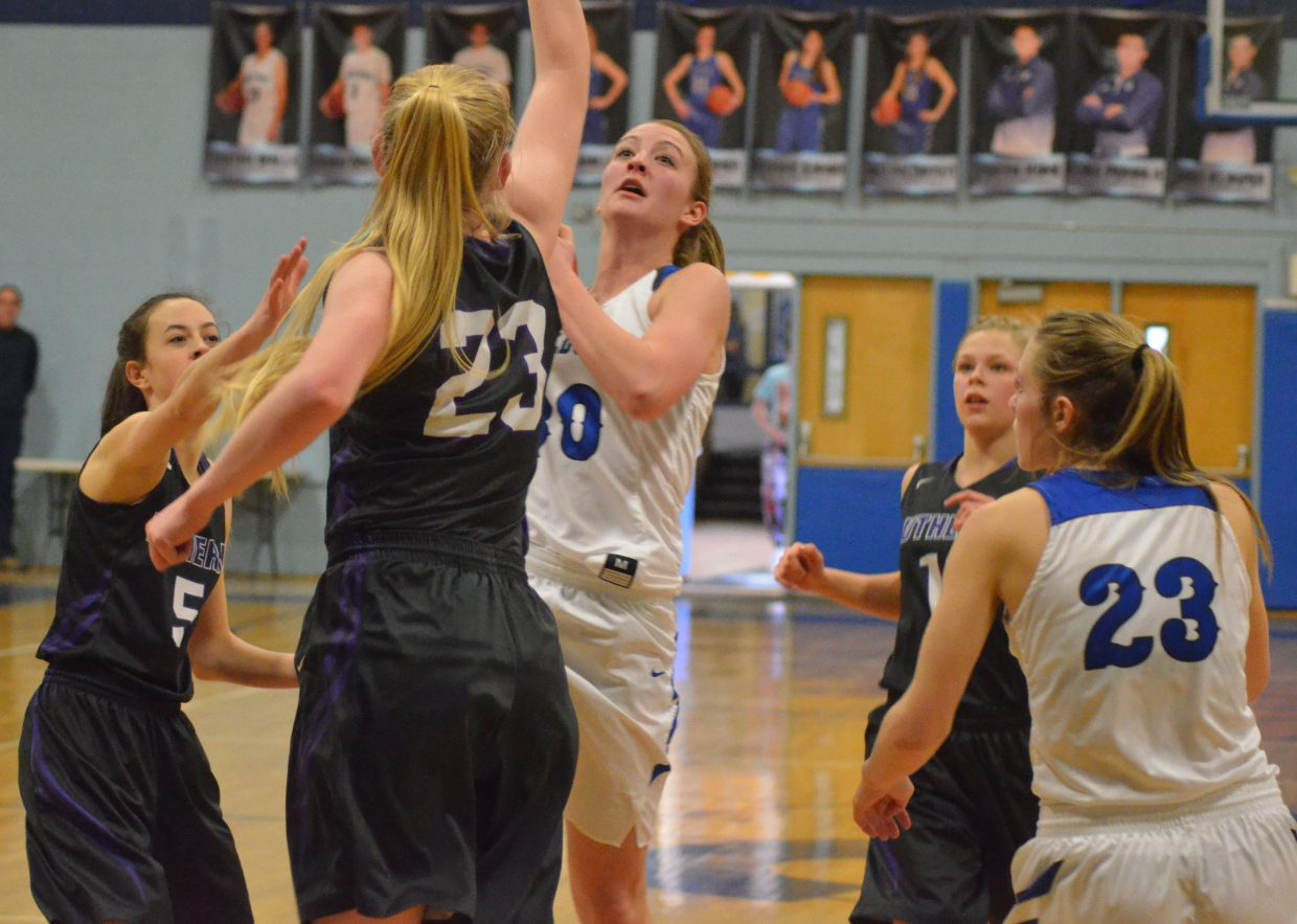 Moffat County High School's Jana Camilletti leans in against Lutheran's Haley Shaklee to draw a foul.