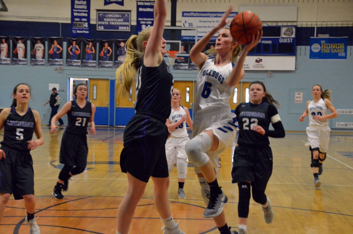 Moffat County High School's Kinlie Brennise goes in for the layup against Lutheran.