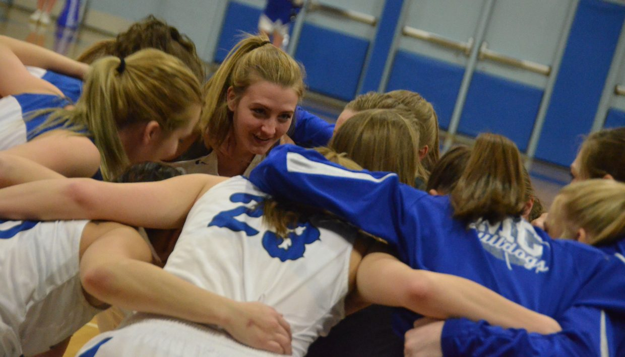 Moffat County High School girls basketball players huddle up and get their energy gathered during pre-game warmups.
