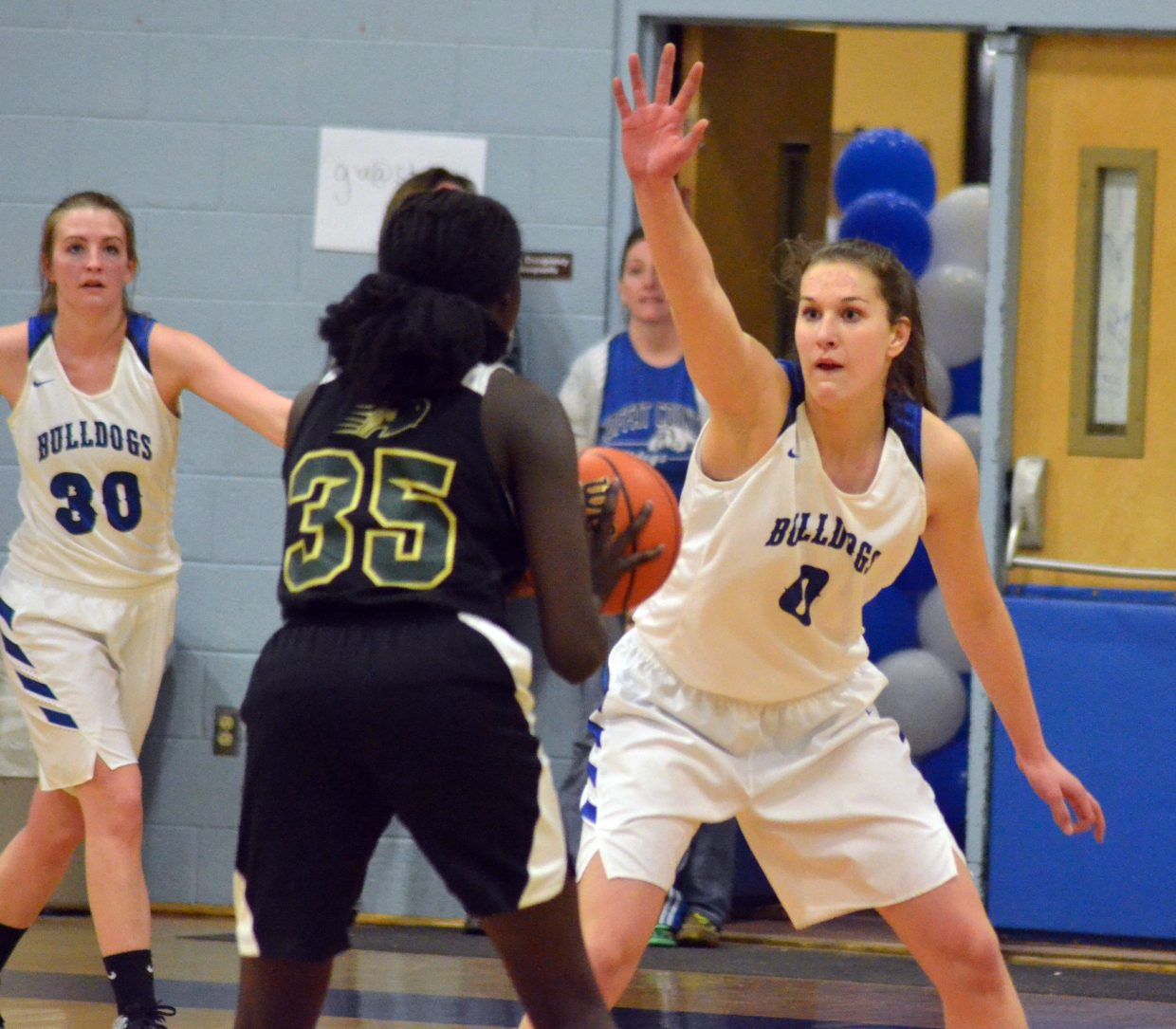 Moffat County High School's Brooke Gumber dares Bishop Machebeuf's Adet Mabeny to make a move.