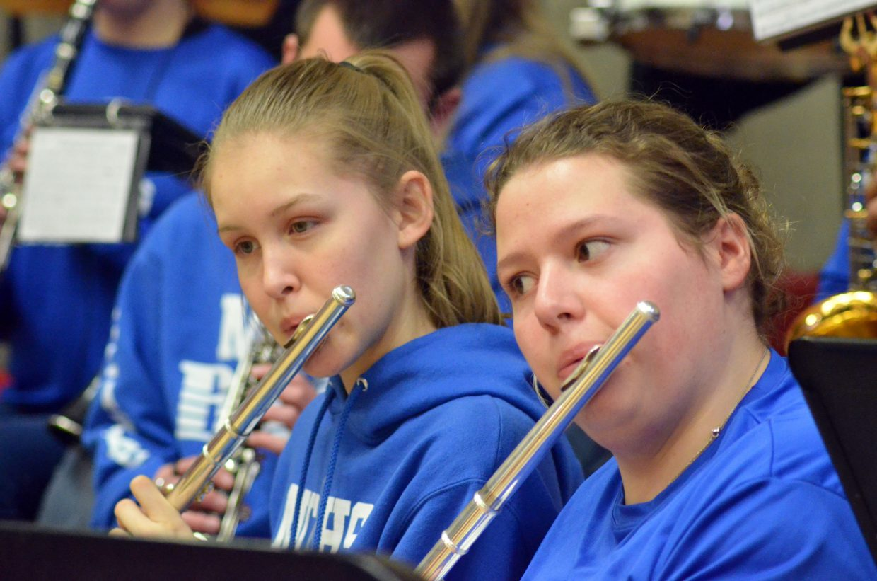 Flautists with the Moffat County High School band keep the Bulldog crowd entertained during a timeout.