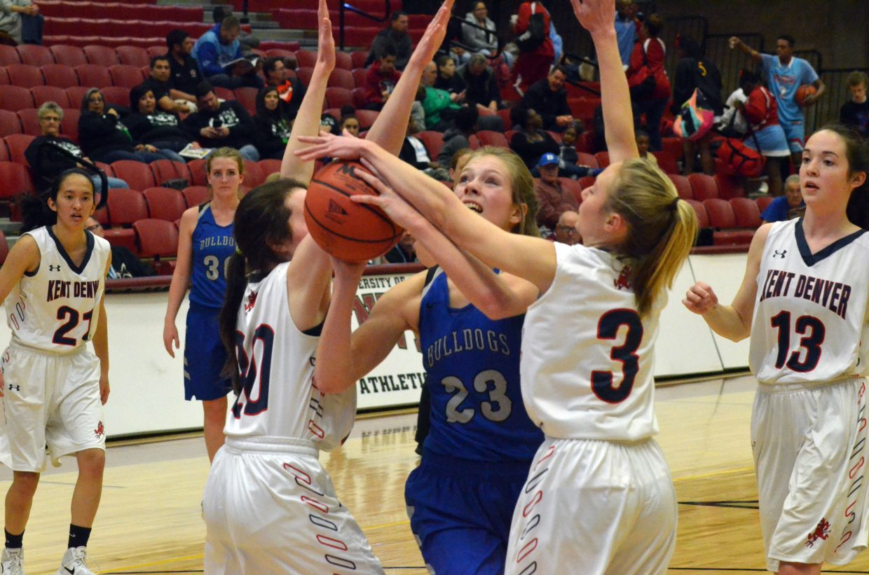 Moffat County High School's Jaci McDiffett is fouled by Kent Denver as she attempts a shot.