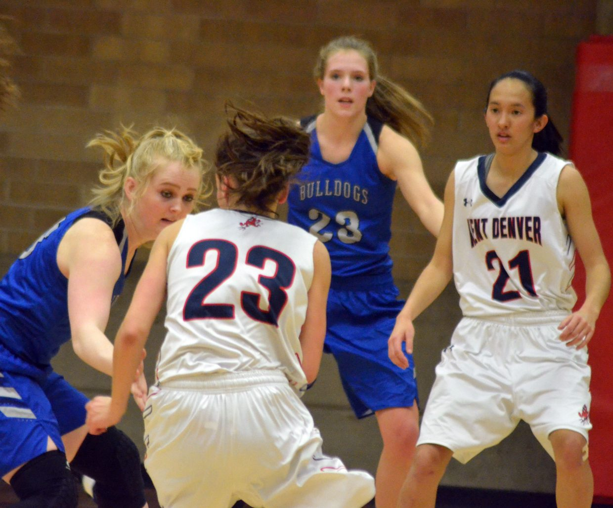 Moffat County High School's Jaidyn Steele and Jaci McDiffett look to slow down the Kent Denver offense.