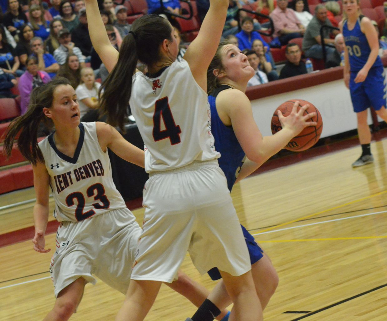 Moffat County High School's Tiffany Hildebrandt whips around to put up a shot against Kent Denver.