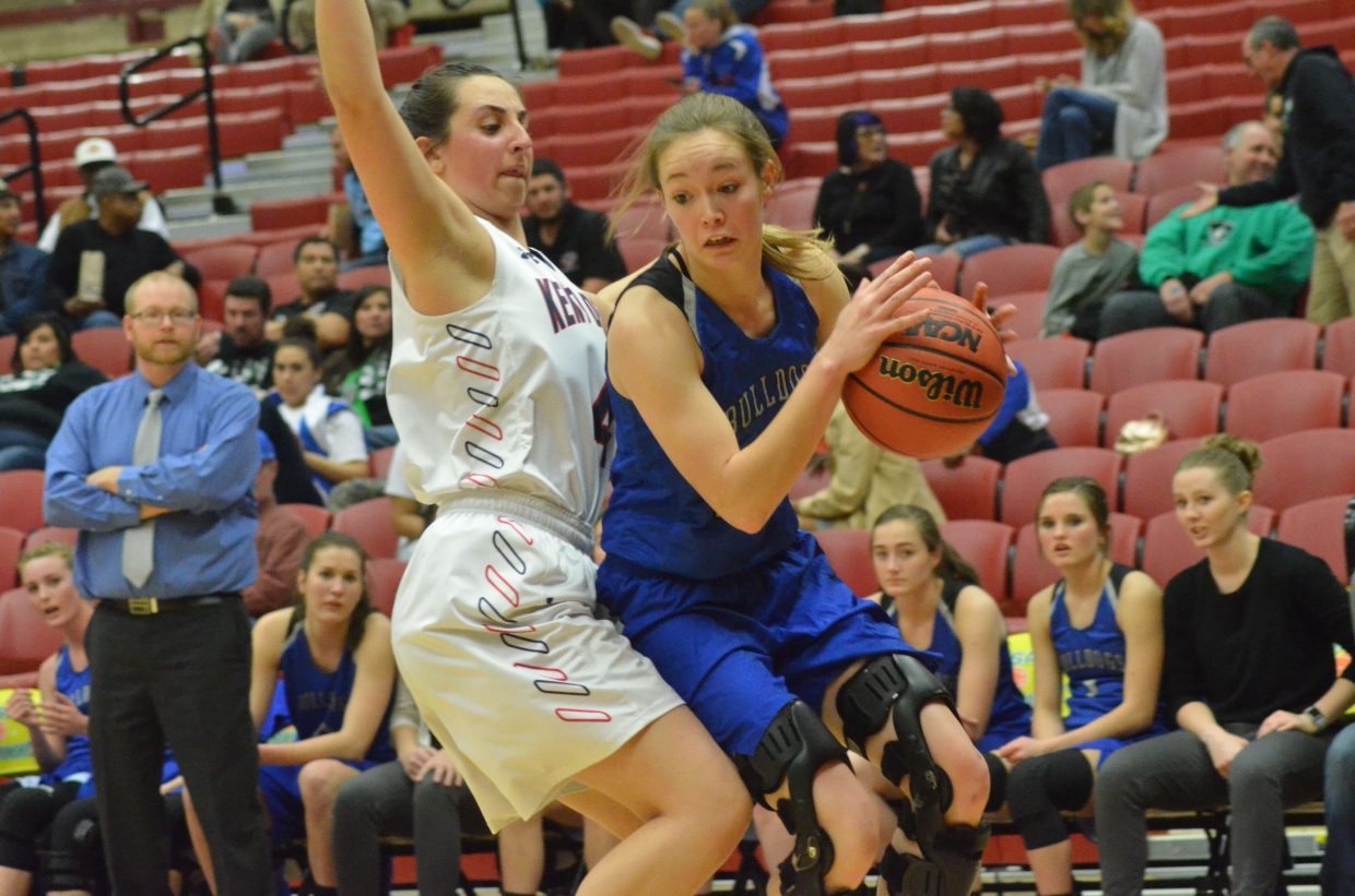 Moffat County High School's Madie Weber stays at the baseline against the Kent Denver defense.