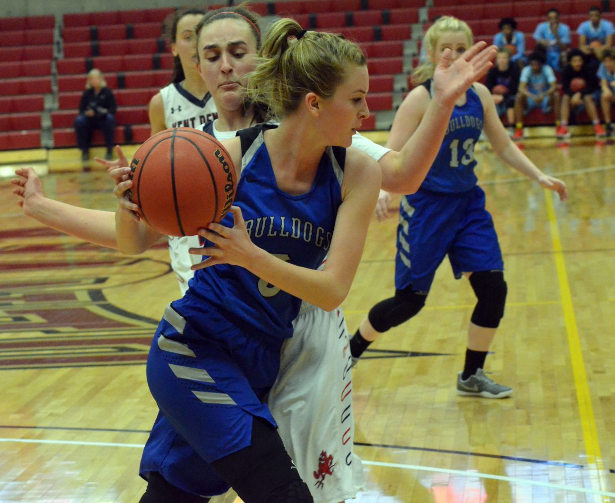 Moffat County High School's Kinlie Brennise looks to pass back to teammate Jaidyn Steele.