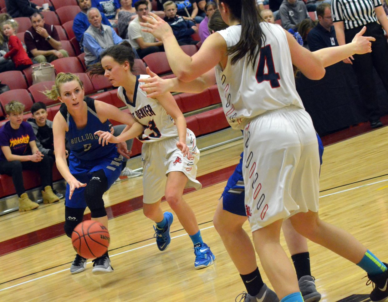 Moffat County High School's Kinlie Brennise fires off a bounce pass to teammate Tiffany Hildebrandt.