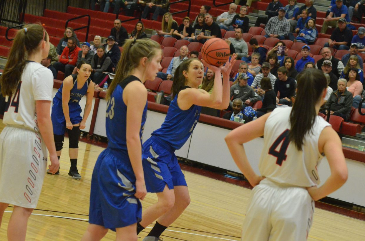 Moffat County High School's Brooke Gumber aims her first of many foul shots against Kent Denver.