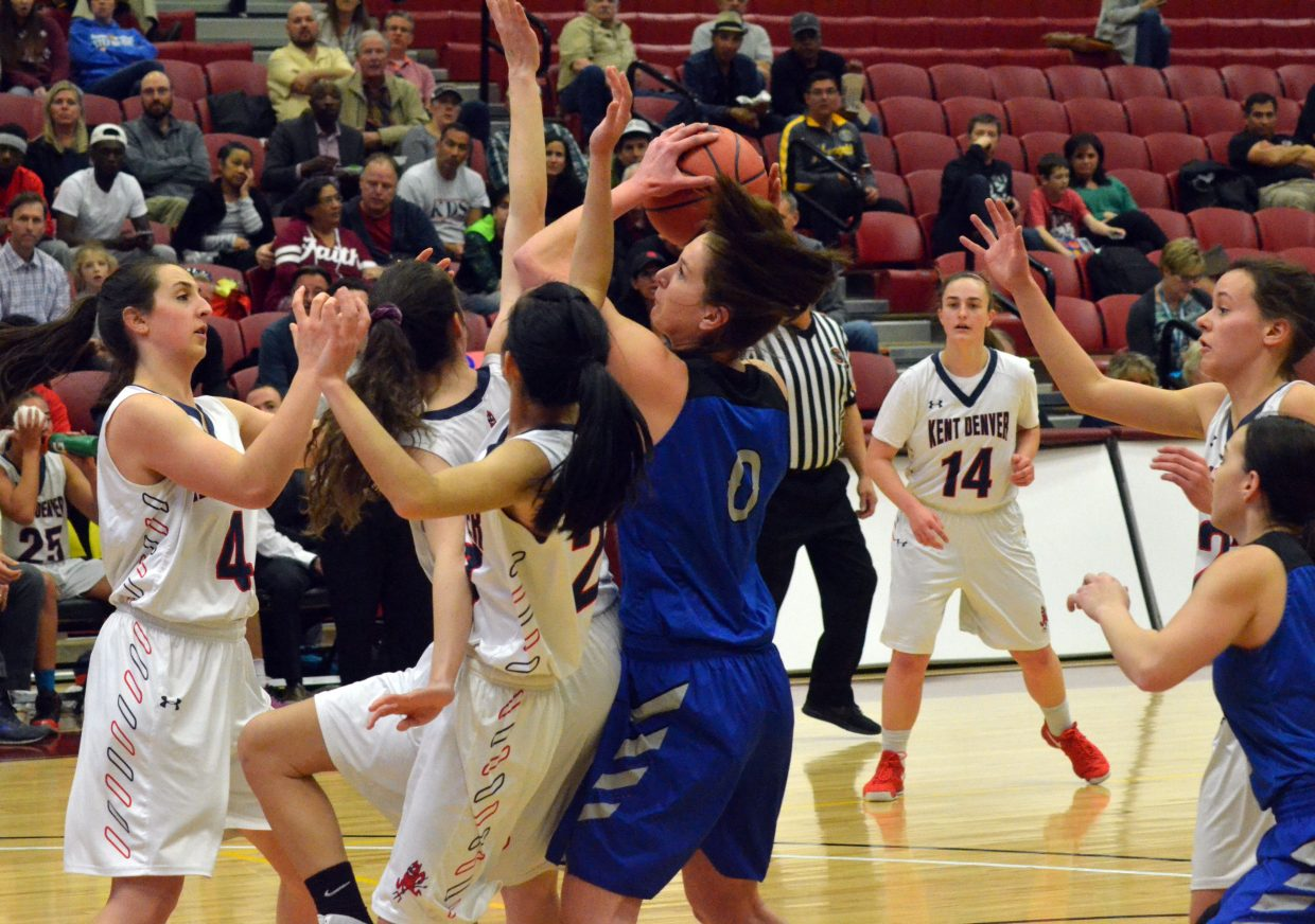 Moffat County High School's Brooke Gumber pulls down the rebound.