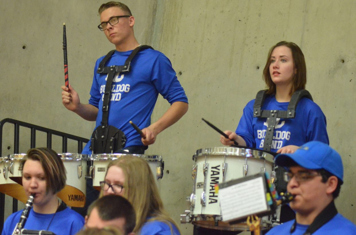 The percussion section of the Moffat County High School band stay lively during a timeout.