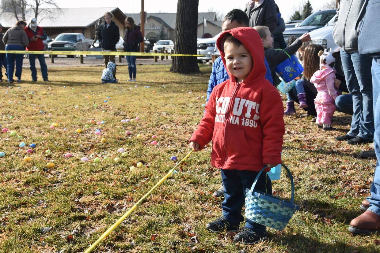 Alex Ayala, 2, waits for the State Farm Easter Egg hunt to begin. His brother Eric Ayala, 3, stands behind him.